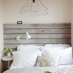 Bedside Table Height White Wall Sconces Wood Plank Headboard White Pillows White Pedestal Side Table Green Blanket