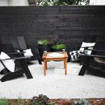 Black Modern Wooden Chairs Around Brown Coffee Table