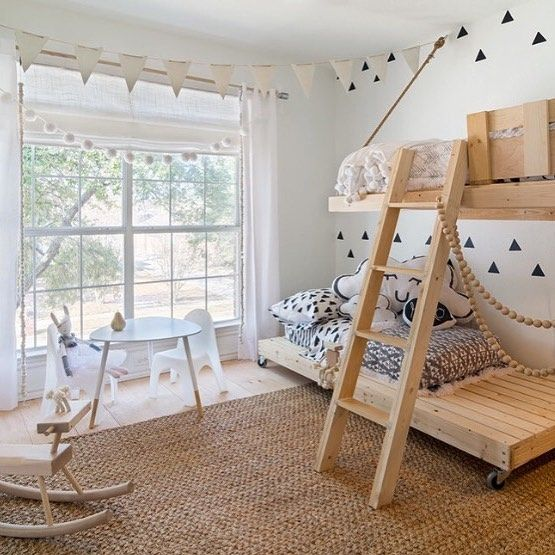 bunk beds with wooden boards platform, wooden floating top bed, woven rug, wooden floor, white mini dining set