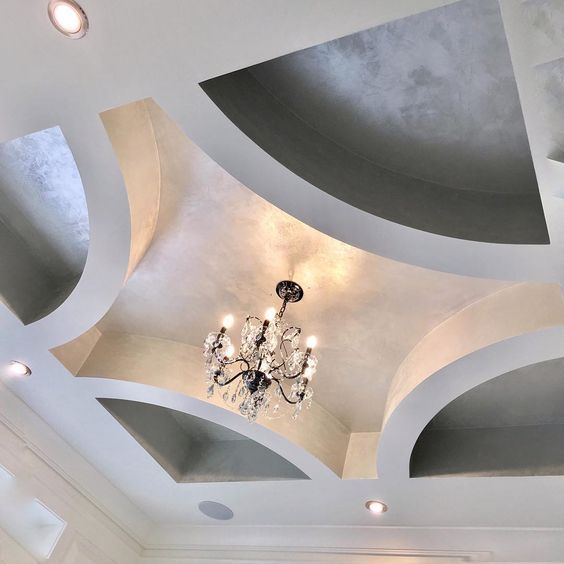 ceiling with patterned coffered, silver painted part inside, chandelier