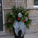 Christmas Decoration With Silver Cones, Red Glossy Holy Berries, Green Pine Leaves, Dried Branch, Silver Ribbon, Black Pot