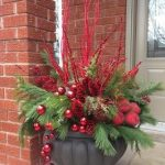 Christmas Ornaments In A Pot With Red Holly Fruits, Green Pine Leaves, Red Branches