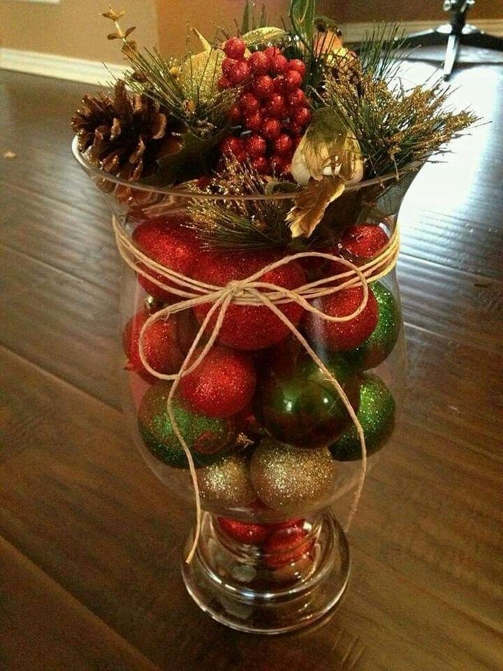 clear glass with red, green, gold balls, fake red fruits, pines, cones