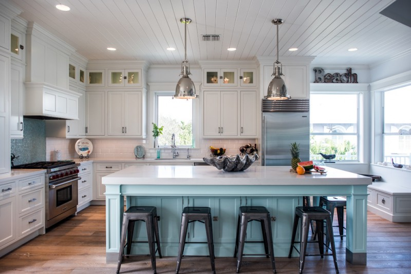 coastal light fixtures white cabinet blue mosaic backsplash nickel pendant lamps wooden floor blue island white countertop black stools sink stovetop glass windows window seat