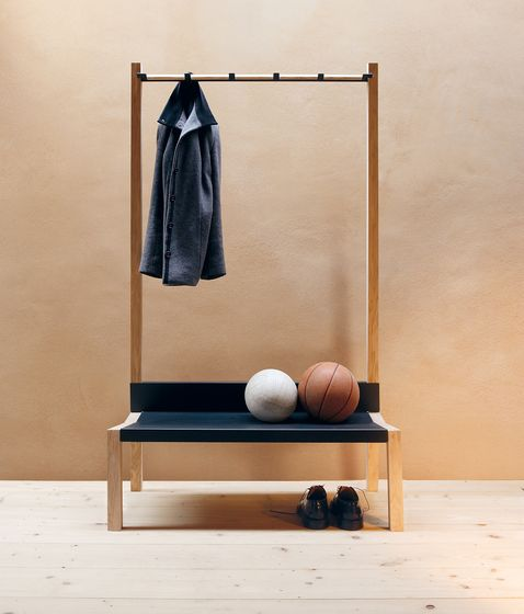 coat rack and bench with wooden material, black leather bench