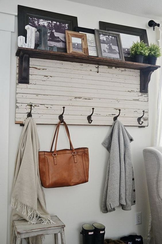 coat rack with hook on white wooden board under shelves