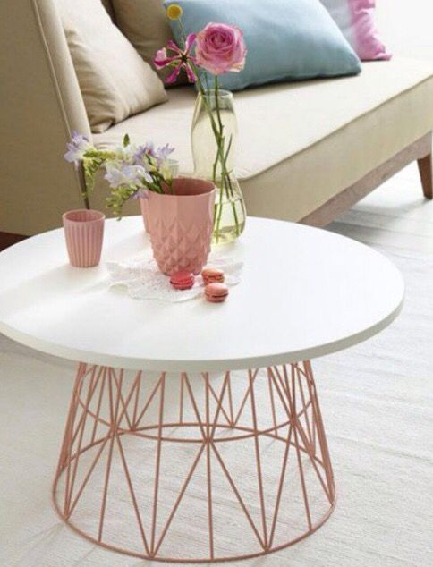 coffee table with white round table, pink wire legs from basket