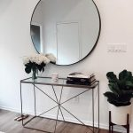 Console Table With Glass Top, Thin Metal Wire Support, Books, Vase, Large Round Mirror, Plants On The Floor