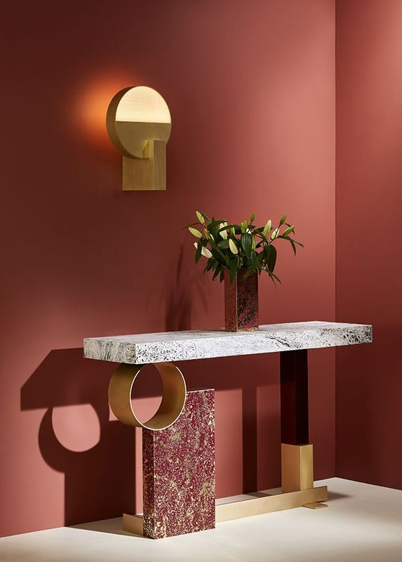 console table with red marble, golden round golden and red metal pole, white marble top