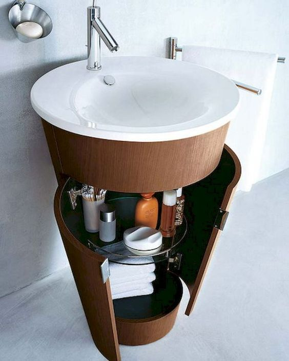 cylinder vanity with white round basin, wooden cylinder cabinet under the sink