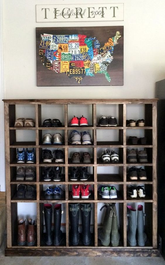 dark simple shoe racks with taller space below for boots