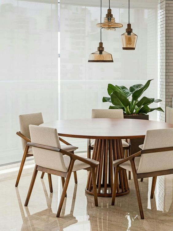 dining room, brown marble floor tiles, white walls, white shade, wooden round table with lattice legs, wooden chairs with white cushion