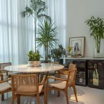 Dining Room, White Floor Tiles, White Round Table, Wooden Chairs With Whte Cushioins, White Walls, White Curtains, Plants