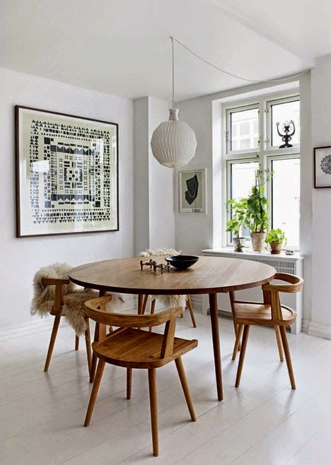dining room, white wooden floor, wooden round dining table, wooden chairs, white wall, white pendant