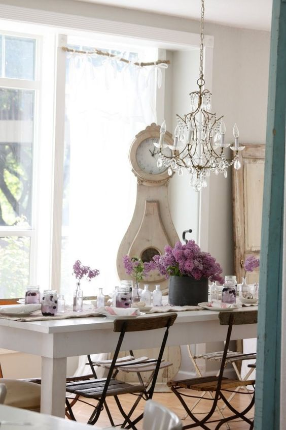 dining room, wooden table, white wooden table, wooden chairs, crystal chandelier, white wall