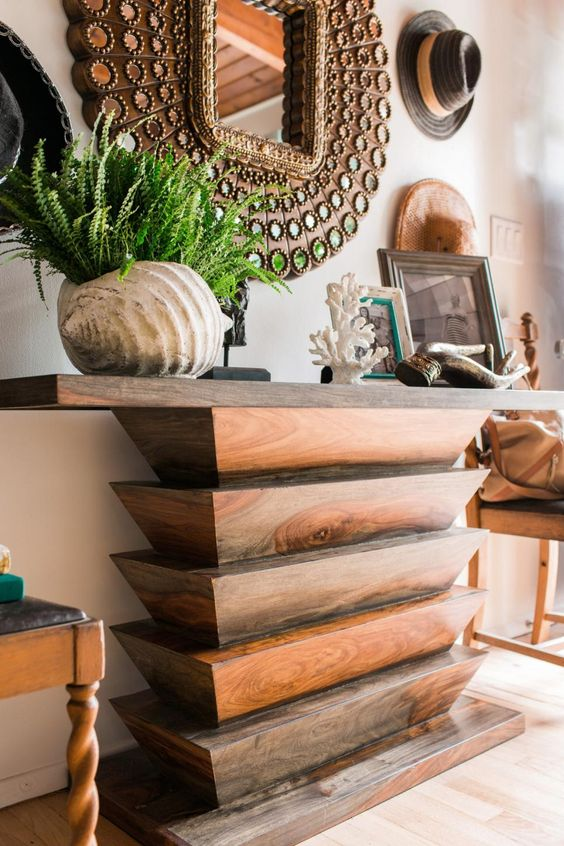 entrance, wooden floor, wooden console table, wooden round mirror in the wall with round glasses, wooden chairs,
