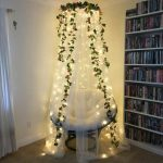 Fairy Lights Around The Curtains Hung Around A Chair Near A Bookshelves, With Faux Plants Hung