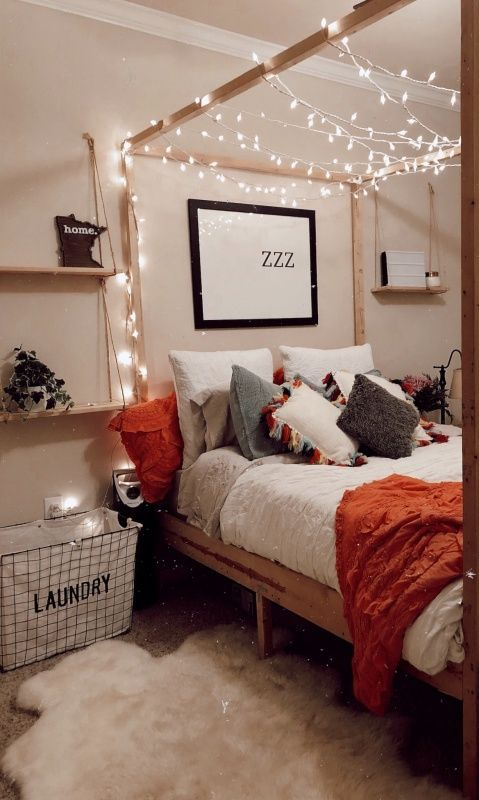 fairy lights arranged on the bed frame above like curtains