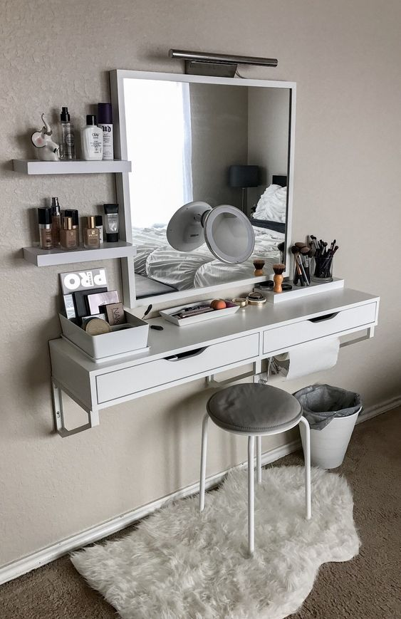 floating drawers with shelves on top, large square mirror, white stool, white rug