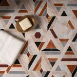 Floor With Mosaic Tiles In Warm Colors Of Orange, Brown, Grey, Black, White