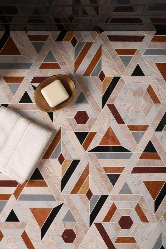 floor with mosaic tiles in warm colors of orange, brown, grey, black, white