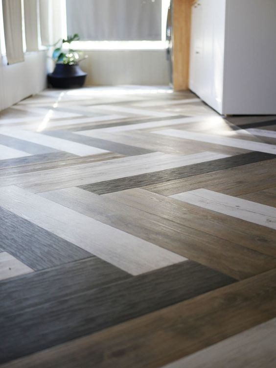floor with wood pattern tiles in herringbone pattern