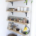 Four Small Wooden Open Shelves With Little Black Metal Support, Ingedients, Baskets, Plants