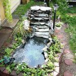 Garden Pond With Bricks Built, Water System Running From One Side, Plants Around