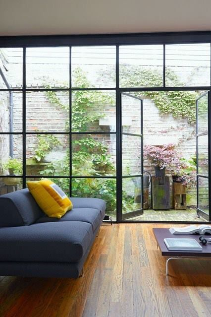 glass wall and door from the living room to the yard