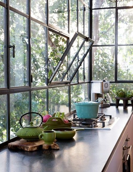 glass wall with black metal frame with some windows on the kitchen