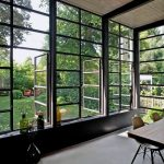 Glass Wall With Some Glass Windows In Black Metal Frame