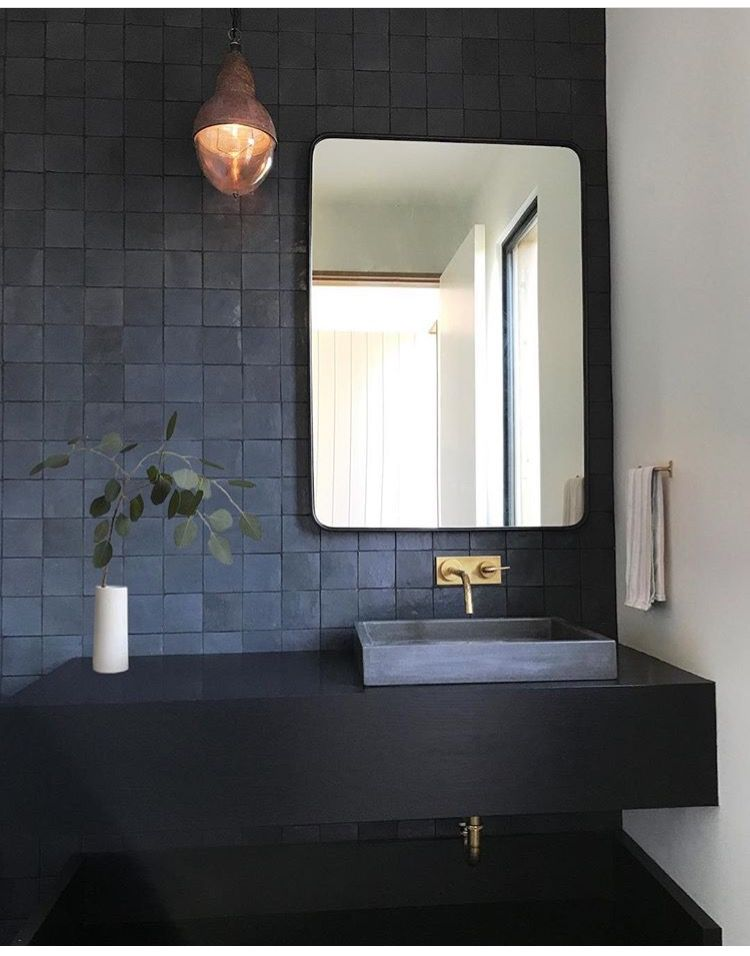 grey bathroom vanity with grey blue square sink, golden faucet, grey square tiles, square mirror, golden pendant