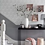 Grey Entrance With Grey Wallpaper, Grey Painted Wall, Black Table, Built In Pink Shelves, Grey Basket, Pink Ottoman, White Pot, Black Telephone