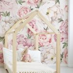 Kids Bedroom With White Wooden Floor, Wooden Platform Shaped Like A House, Pink Large Flowers Wallpaper