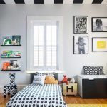 Kids Bedroom With Wooden Floor, Yellow Carpet, Black Bench, Black Bed Platform, White Wall, Black White Stripes Ceiling, Shelves, Pictures