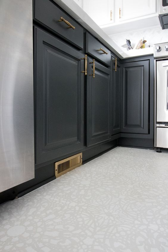 kitchen floor with white patterned linoleum flooring