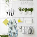 Kitchen Wall With White Tiles, Metal Rail Built In With Hooks, Magnetic Board, Metal Shelves, Metal Plate Racks