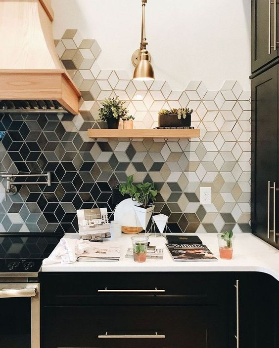kitchen with black cabinet, white counter top, hexagon tiles with pattern and different colors on backsplash