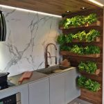 Kitchen With Brown Tiles, White Marble Walls, Wooden Wall With Shelves And Plants, Wooden Ceiling