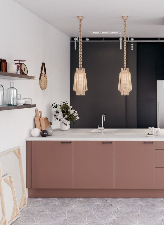 kitchen with geometric pattern on white tiles on floor, white wall, wooden shelves, blak cupboard on the back, pink island with white islan top, golden pendant