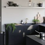Kitchen With Grey Floor, Black Cabinet, Off White Walls And Open Shelves