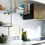 Kitchen With Metalic Cabinet, White Countertop, Marble Wall, Metal Glass Shelvs
