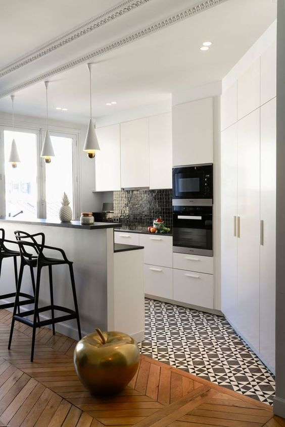 kitchen with white cabinet under black kitchen top, white cabinet on top, white storage cupboard, island with black stool