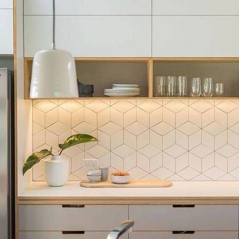 kitchen with white cabinet, white cupboard with shelves, white geometric backsplash, white pendant