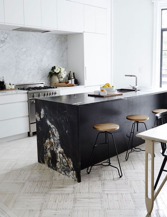 kitchen with white floor tiles, white marble on backsplash, white cabinet, white wall, black marble island