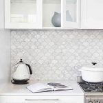 Kitchen With White Wooden Cabinet With White Counter Top, White Cupboard, White Fish Scales Backsplash