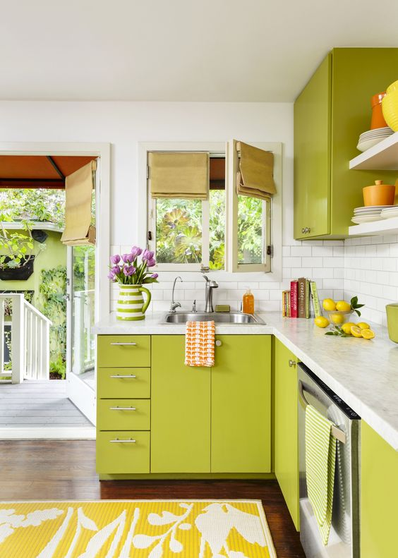 kitchen with wooden floor, yellow rug, lime cabinet with white counter top, lime cupboard on top, white subway backsplash, white open shelvs