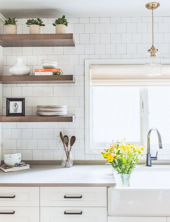 kitchen withwhite tiles wall, brown wooden floating open shelving