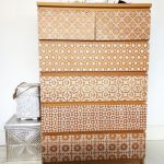 Light Brown Drawers On Cabinet With Different Tribal Pattern On Each Drawers