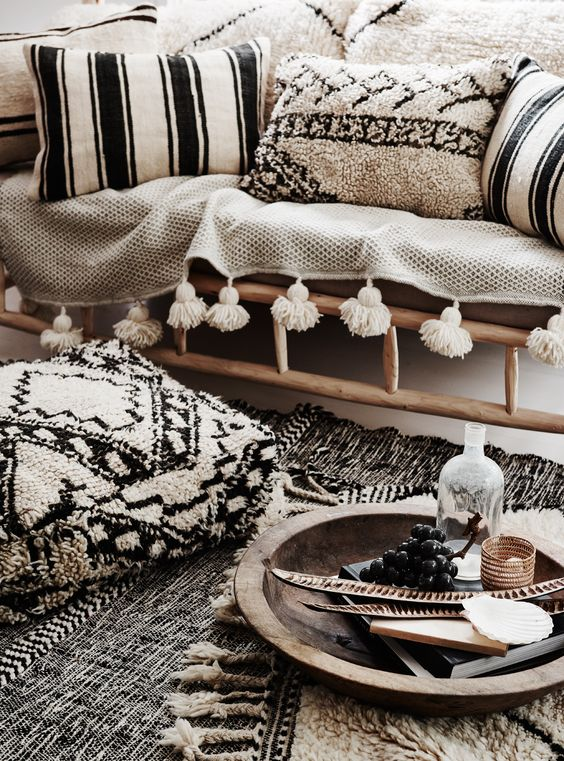 living room with rug, pillows with warm material cover, bench with blanket